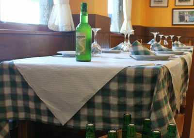 The bottle of cider on the table